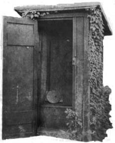 An early 20th century outhouse with a fanciful design.